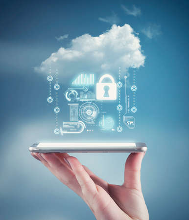 Foto de Hand holding a phone with a cloud and personal data information. The concept of personal data security - Imagen libre de derechos