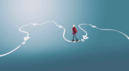 Photo pour Young man wearing a backpack follows a path drawn on the ground. - image libre de droit