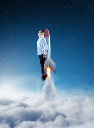 Photo for Young businessman flying above clouds with a rocket. Launch start up business concept. - Royalty Free Image