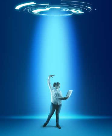 Foto de Programmer working on laptop in a futuristic background. - Imagen libre de derechos