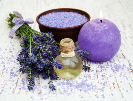 Lavender, sea salt and candle on a wooden background