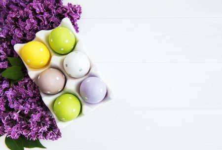 Photo for Easter eggs in tray with lilac flowers - Royalty Free Image