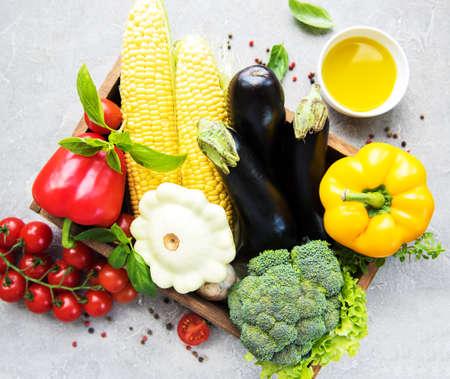 Photo pour different raw vegetables and olive oil on a concrete background - image libre de droit