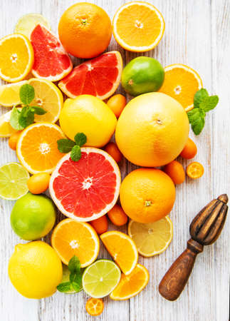 Photo for Fresh citrus fruits on a old wooden background - Royalty Free Image