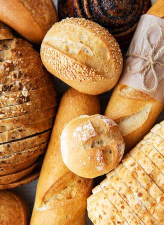 Foto für Assortment of baked bread on white wooden background - Lizenzfreies Bild