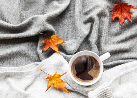 Photo for Autumn and winter home still life . The view from the top. The concept of home atmosphere and decor. Cup of coffee and autumn leaves  - Royalty Free Image