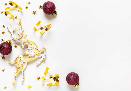 Photo pour Christmas composition. Red and golden  decoration on white background. Christmas, winter, new year concept. Flat lay, top view, copy space - image libre de droit