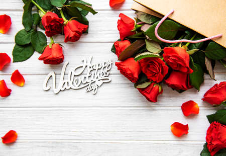 Photo for Frame made of red roses, petals   on white wooden background. Flat lay, top view, copy space. - Royalty Free Image