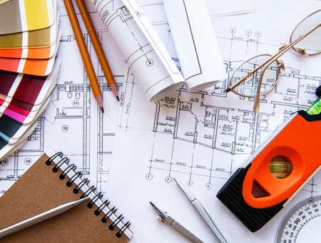 Photo pour Architect workplace top view. Architectural project, blueprints, blueprint rolls on table. Construction background. Engineering tools. Copy space - image libre de droit