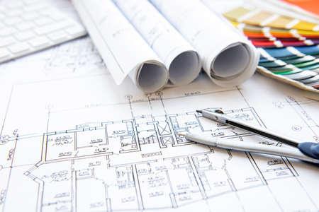 Foto de Architect workplace top view. Architectural project, blueprints, blueprint rolls on table. Construction background. Engineering tools. Copy space - Imagen libre de derechos