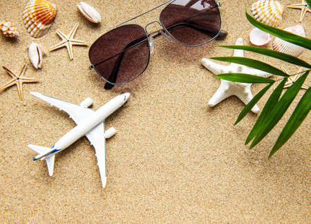 Photo for Top view of traveler background on tropical sand, shells and airplane. Background for summer holiday vacation travel trip. Flat lay, copy space - Royalty Free Image