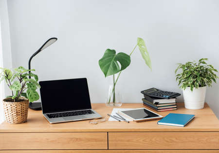 Photo for Office workplace with laptop on wooden table - Royalty Free Image