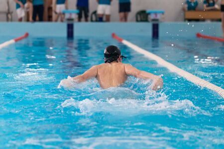 Photo pour Swimming pool athlete training indoors. Guy doing butterfly - image libre de droit