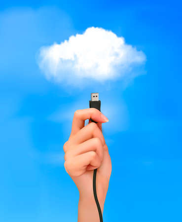 Hand holding cable connected to the cloud  Concept of cloud computing