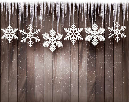 Illustration pour Christmas background with snowflakes and icicles in front of a wooden wall. - image libre de droit
