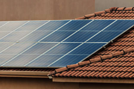 Photo for Solar photovotaic panel at a roof at suset.  Solar energy house company concept image. - Royalty Free Image