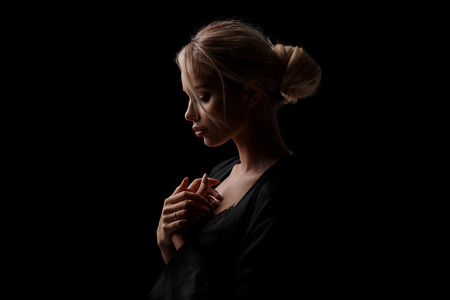 Photo pour Sexy beautiful young woman in black stylish clothes on a black isolated background - image libre de droit
