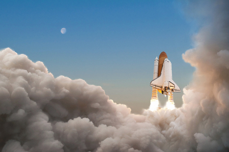 Photo for Space Shuttle starts its mission and takes off into the sky. Rocket with clouds of smoke flying into space - Royalty Free Image