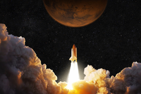 Photo for Spacecraft takes off into space. Rocket flies to Mars. Red planet Mars in space - Royalty Free Image