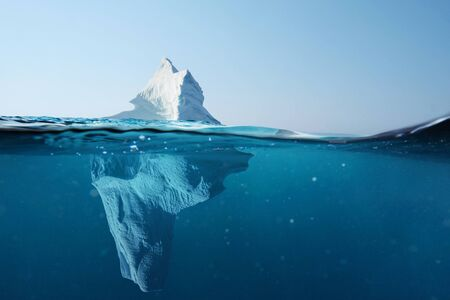 Foto de Iceberg in the ocean with a view under water. Crystal clear water. Hidden Danger And Global Warming Concept - Imagen libre de derechos