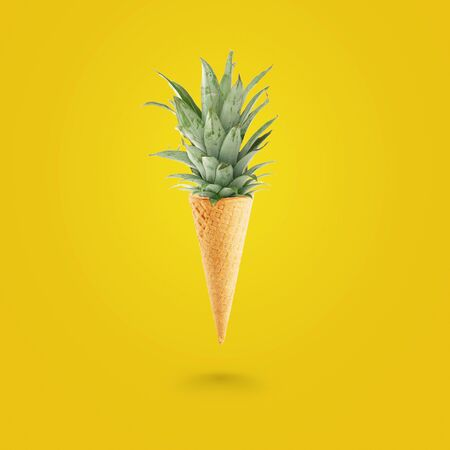 Photo pour Summer concept, Ice cream cone with pineapple leaves on bright yellow background. Healthy food - image libre de droit