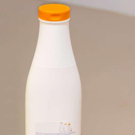 White bottle of shower gel in the bathroom floor