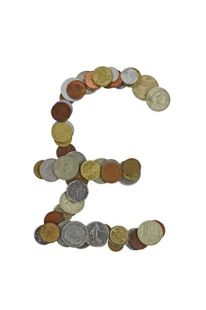Pound sterling sign, laid out with small coins of different countries, mostly obsolete