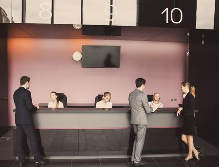 Foto de Business people at reception or front desk in office building, hotel or airport - Imagen libre de derechos