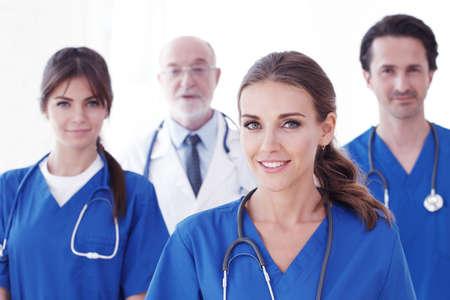 Photo pour Team of professional doctors in blue uniform isolated on white background - image libre de droit