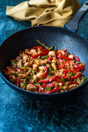 Photo for Homemade Spicy Szechuan Chicken / Dragon Chicken in Wok. Traditional Asian Dish. - Royalty Free Image