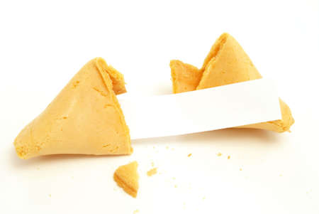 A fortune cookie on white background with a blank paper for your message.
