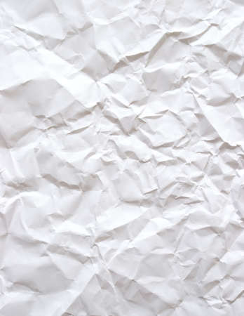 A piece of plain white bond paper that has been wrinkled.