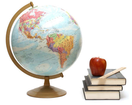A globe and textbooks for a geography class are isolated on white.