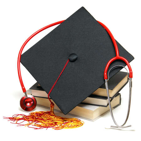 Photo pour An isolated stethoscope and mortarboard represent a graduating healthcare professional. - image libre de droit