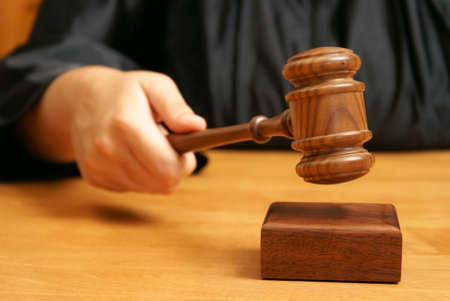 A professional judge declares the legal proceeding with a final hit using the gavel.