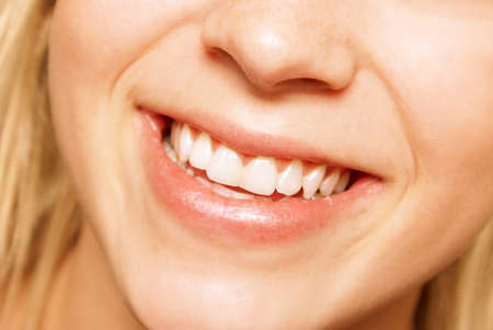 Photo for A young woman smiles happily at the viewer in this closeup image. - Royalty Free Image