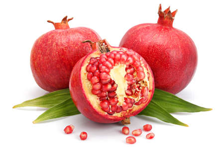 Photo pour Pomegranate fruits with green leaf and cuts isolated on white background  - image libre de droit