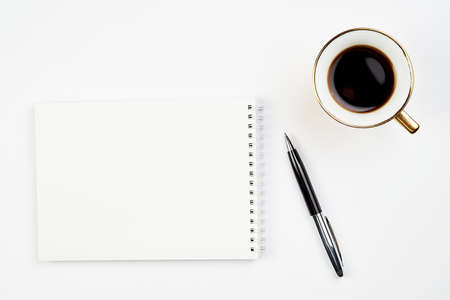 Photo for white office Desk top view with Notepad, pen and coffee Cup, minimalistic design, top view,copy space,flat lay - Royalty Free Image