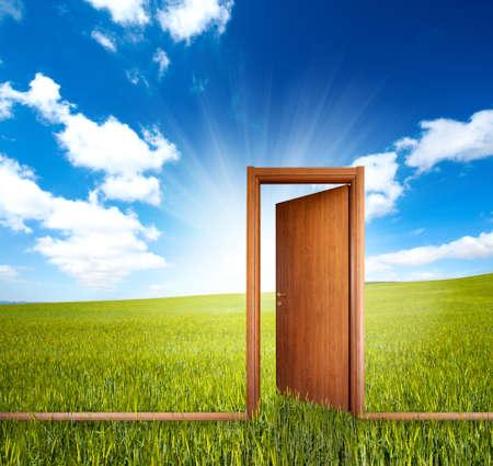 Photo pour Home door open in a green clean field - image libre de droit