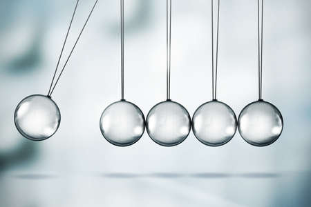 Shiny Newton's cradle illustration