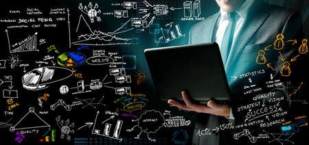 Photo pour Businessman at work with ne ideas - image libre de droit