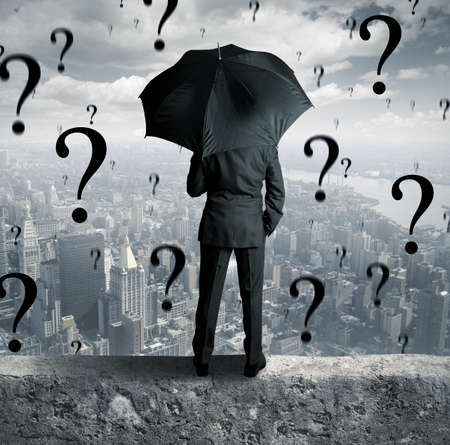 Concept of businessman surrounded by questions