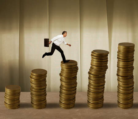Jumping businessman in a stack of money