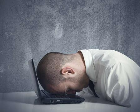 Foto de Concept of stressed busibnessman at work - Imagen libre de derechos