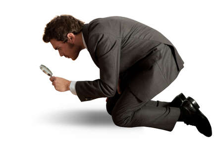 Concept of businessman that search business with lens