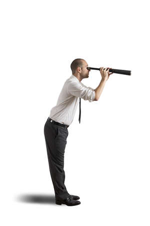 Businesswoman with telescope on white background