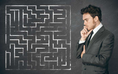 Businessman seek the solution of a complex maze