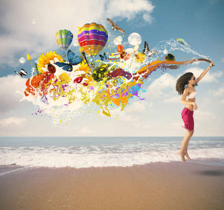 Summer color explosion with jumping girl at the beach