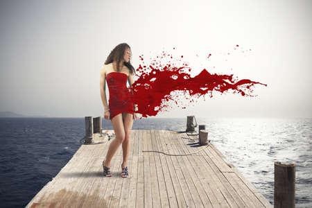 Foto de Creative fashion explosion with red dress - Imagen libre de derechos