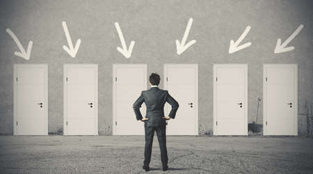Foto de Concept of businessman choosing the right door - Imagen libre de derechos